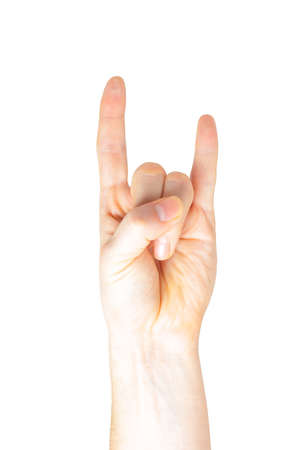 devil horns: Male hand with devil horns rock metal sign symbol gesture Stock Photo