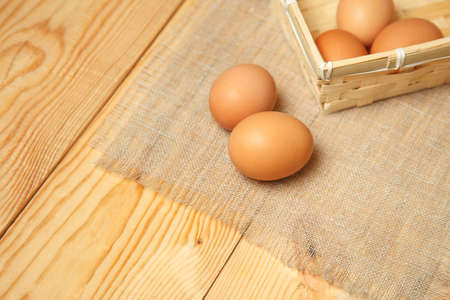 aliment: Fresh farm eggs on a wooden rustic background
