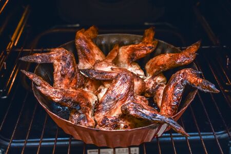 baked chicken wings in the oven at home during quarantine isolation