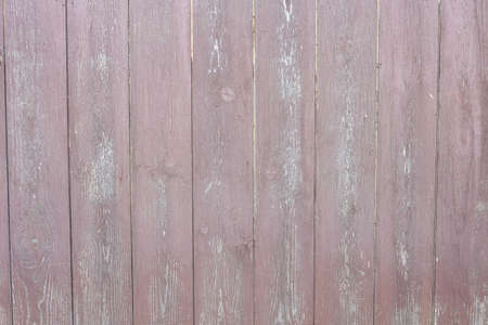 old wooden fence. wood texture with peeling paint.