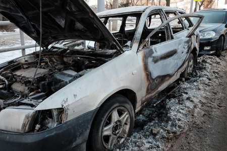 car burnt on the side of the road.