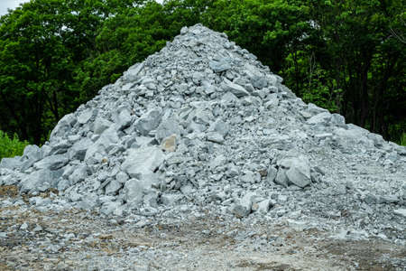 A pile of building crushed stone crushed stone at a construction site.