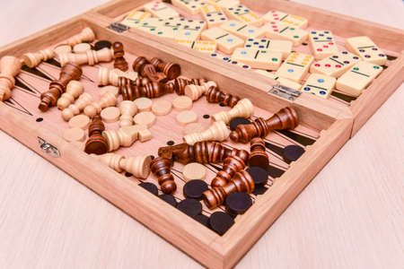 checkers, chess, dominoes and backgammon. set of board games
