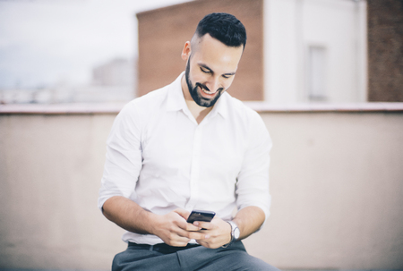 Attractive man and beard with mobile phone.