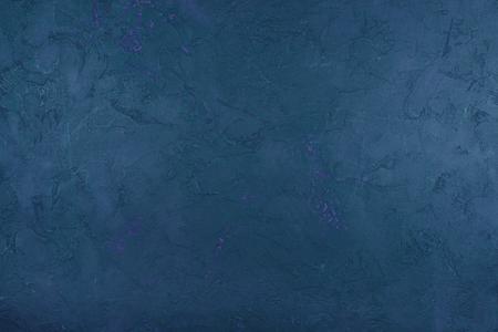 Colored concrete texture. Rough natural concrete Surface. Dark blue.