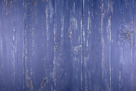 Wooden texture background. The surface of the old wood texture. The boards are painted in dark blue. The boards are arranged vertically.