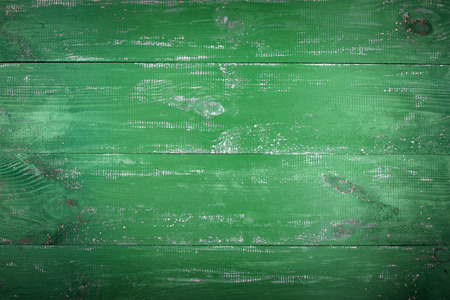 Wooden texture background. The surface of the old wood texture. The boards are painted in green. The boards are arranged horizontally.