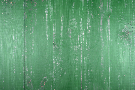 Wooden texture background. The surface of the old wood texture. The boards are painted in green. The boards are arranged vertically.  Stock Photo