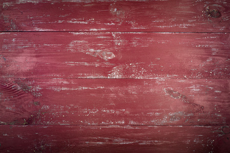 Wooden texture background. The surface of the old wood texture. The boards are painted in red. Iron minium color. The boards are arranged horizontally