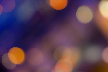 Abstract bokeh background. Defocused colored circles on a blue background. Place for text, copyspace. Out of focus blur.
