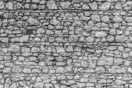 Stone wall of a medieval castle. Masonry. Wall of boulders. Background, texture. Stock Photo