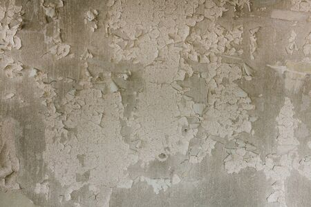 Texture of old shabby peeling paint on a gray surface