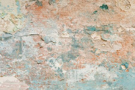 Texture of old shabby peeling red, blue paint on a gray surface