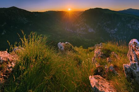 Beautiful sunrise in the mountains. Mountain gorge. View of the canyon of the Tara River, Montenegro Stock Photo