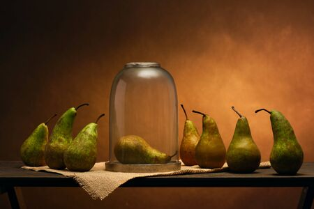 Scene played with pears. Quarantine funeral. Insulation, glass crystal coffin. Allegory Snow White and the Seven Dwarfs