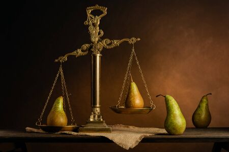 Court and justice concept. Metaphor. Life scene played out with pears