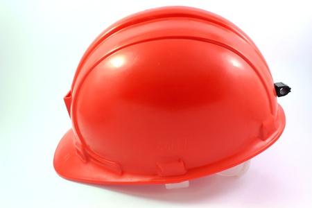 casco rojo: casco rojo sobre un fondo blanco