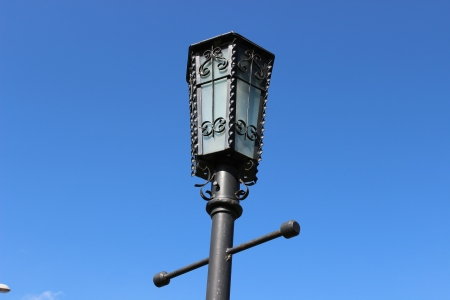 ancient lamp against the dark blue sky