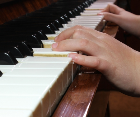 hand on piano keys Stock Photo
