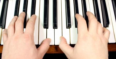 hand on piano keys Stock Photo