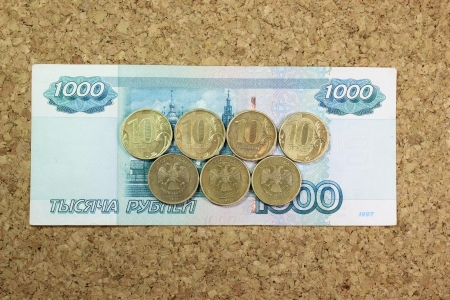 ten-ruble coins on the thousand note