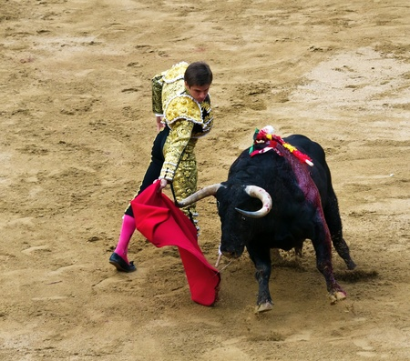 BARCELONA - SEPTEMBER 24:Julian Lopez El Juli in action during a corrida de toros or bullfight, typical Spanish tradition where a torero or bullfighter kills a bull on Septiembre 24, 2011 in Barcelona, Spain.