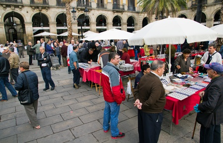 BARCELONA, SPAIN - NOVEMBER 13: Plaza Real on November 13, 2011 in Barcelona, ??Spain. All holidays, collectors gather to buy stamps and coin collection. Editorial