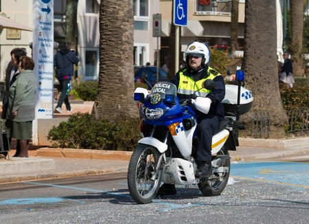 light duty: Lloret de Mar, Spain. motorcycle police officer in action.  Editorial
