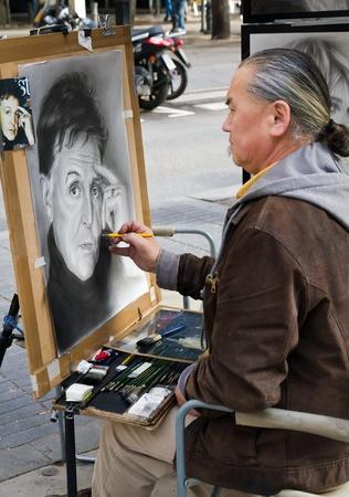the ramblas: BARCELONA, SPAIN - NOVEMBER 27: Unidentified person, a cartoonist, with a portrait of Paul McCartney, are located in Las Ramblas de Catalunya, Barcelona