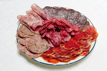 about a lot of Spanish serrano ham and Spanish sausage, fuet, Iberian pork loin Stock Photo - 11739815