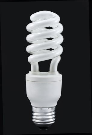 23W compact fluorescent bulb isolated on a black background  photo