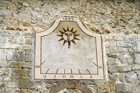 sundial old rustic wall of a Spanish village
