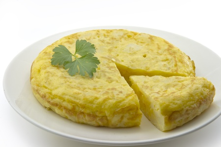 Spanish omelette with potatoes, parsley leaf gift auction, white background Stock Photo