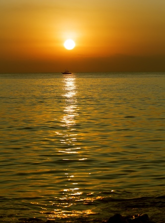 golden dawn in the waters of the Mediterranean in Barcelona Stock Photo - 12756223