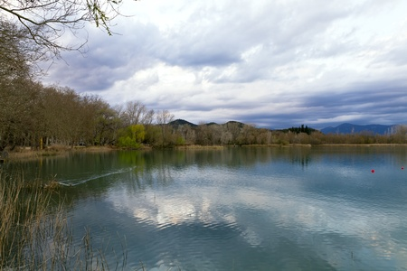 laque: Lake Banyoles in pla de estany, Spain Barcelona, Panoramic Photography at sunset.