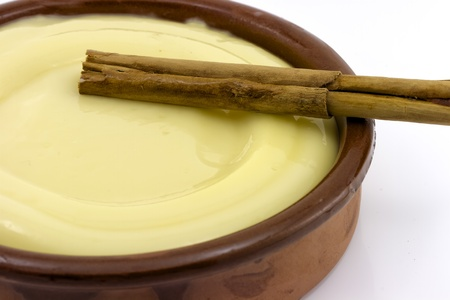 clay bowl, tasty dessert custard and cinnamon, detail Stock Photo
