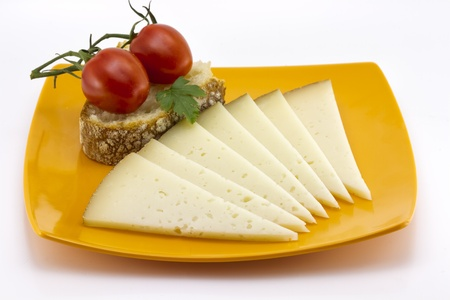 some slices of manchego cheese from Spain, Bread and tomato Stock Photo - 12852403