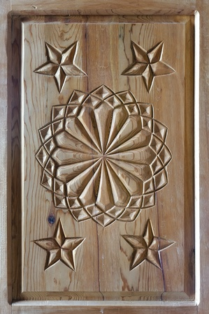 floral tars motifs carved on the old wooden doors.  detail photo