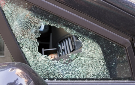 forced car windscreen and broken, stolen by a few coins Stock Photo - 13028680