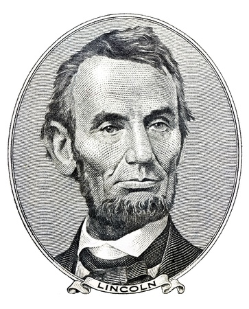 Portrait of former U S  president Abraham Lincoln as he looks on five dollar bill obverse