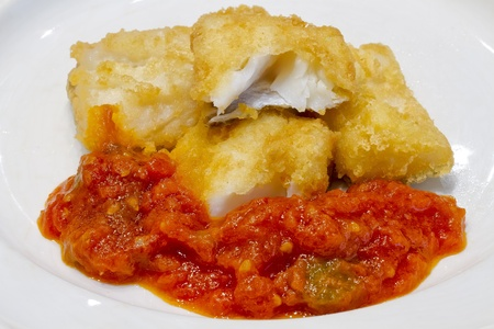 codfish: Fried salted codfish ready for a meal, Biscayan cod in, with tomato pisto Stock Photo