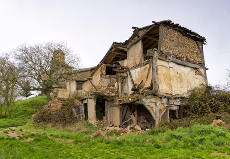 Homes and church in ruins of an abandoned village in the province of Burgos, Spain. Stock Photo - 13759590