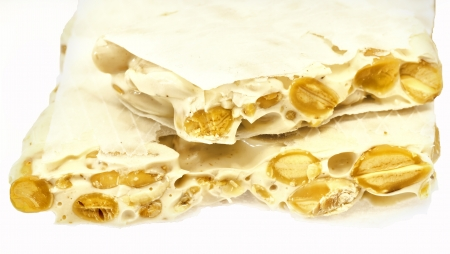 Nougat with almonds on the white Stock Photo - 13864738