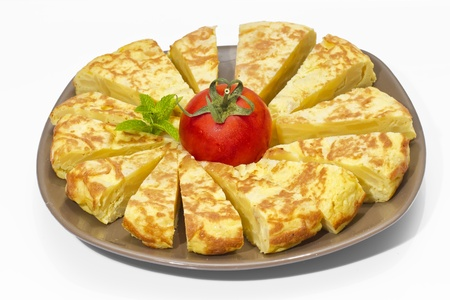 A triangle of potato Spanish omelette on a plate photo