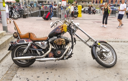 BARCELONA, SPAIN - JULY 08  Customized motorcycle, with a Harley Davidson motorbike at an exhibition during BARCELONA HARLEY DAYS 2012, on July 08, 2012, Barcelona, Spain