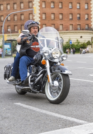 BARCELONA, SPAIN - JULY 08  Unidentified man with a Harley Davidson motorbike at an exhibition during BARCELONA HARLEY DAYS 2012, on July 08, 2012, Barcelona, Spain