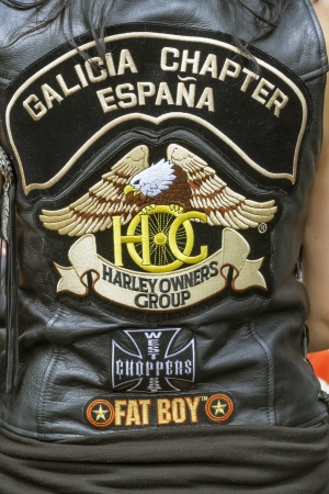BARCELONA, SPAIN - JULY 08  Unidentified persons with typical biker jacket a Harley Davidson motorbike at an exhibition during BARCELONA HARLEY DAYS 2012, on July 08, 2012, Barcelona, Spain