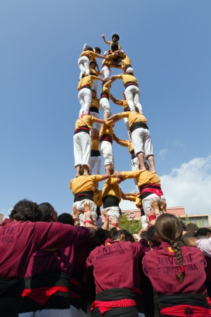BARCELONA - SEPTEMBER 11  Some unidentified people called Castellers do a Castell or Human Tower, typical tradition in Catalonia, on September 11, 2012 in Barcelona, Spain