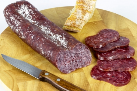 precedent: Iberian sausage sausage on a wooden board