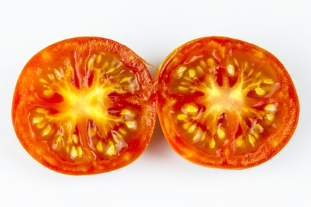 Half a tomato isolated on a white background  photo
